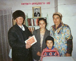 Joseph Tashpulatov's grand-daughter with some of her family and a local tourist guide